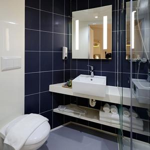 Dark Bathrooms Can Be Beautiful